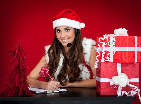 santa girl making list of christmas present wishes photo