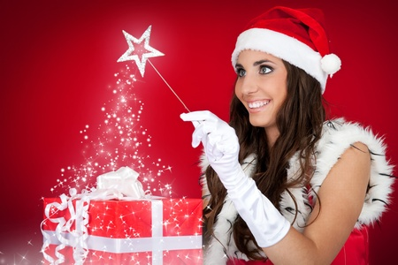 portrait of sexy santas helper with magic wand photo