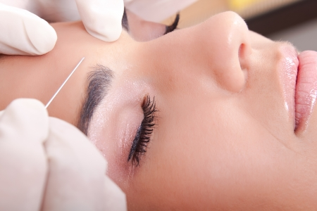 Young Caucasian woman get a botox injection, close up Stock Photo - 8910512