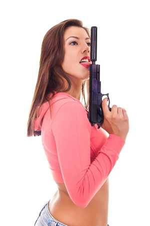 A portrait of a sexy woman licking the tip of a gun, on white background Stock Photo - 8911656