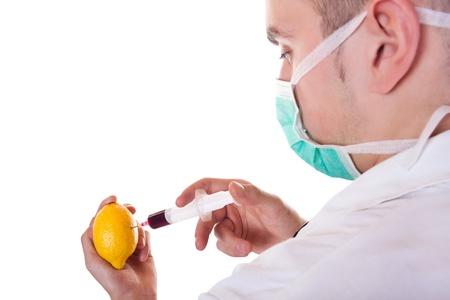 Genetic modification of fresh yellow lemon- isolated on white photo