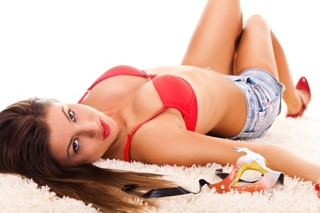 sexy beautiful girl wearing bra and lying on carpet Stock Photo - 9014462