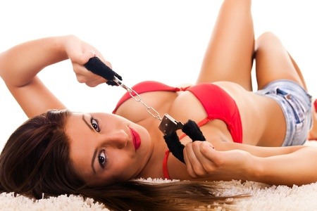 Passionate brunette playing with the handcuffs Stock Photo - 9014465