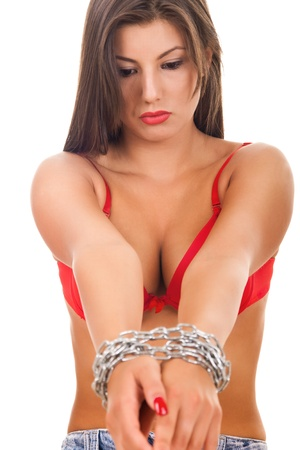 pretty young woman stretches out her hands in chains - isolated on white Stock Photo - 9014467