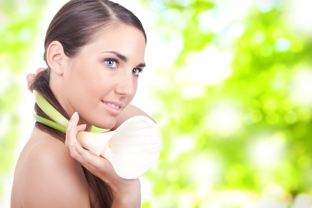 portrait of a beautiful young woman with a white calla flower photo
