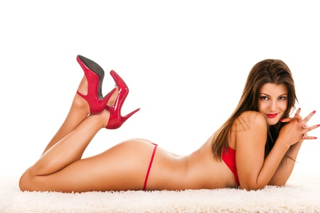 Beautiful young girl posing in a sexy  red underwear Stock Photo - 9077415