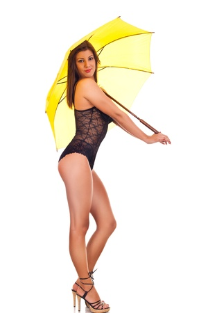 attractive sexy woman under yellow umbrella Stock Photo - 9077402