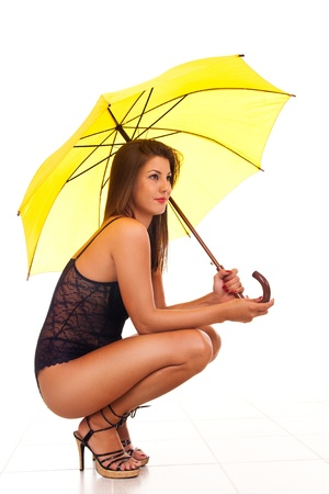 sexy woman in lingerie with umbrella side view photo