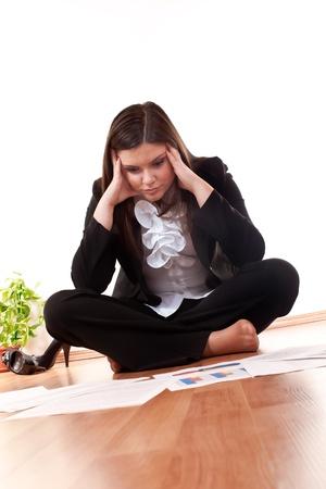 concerned: concerned business woman sitting on floor