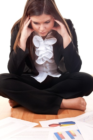 worried caucasian businesswoman sitting on floor photo
