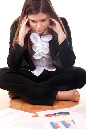 worried caucasian businesswoman sitting on floor photo