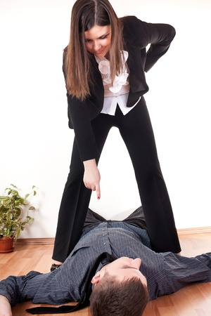 business competition,  businesswoman dominating businessman photo