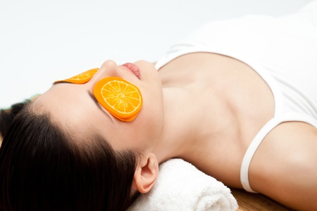 mask on the womans face,  spa with fruit, close up Stock Photo