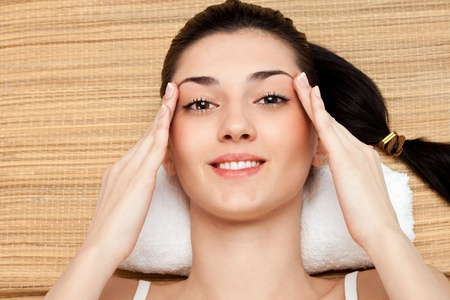 woman massage her head in massage studio, close up Stock Photo - 9129430