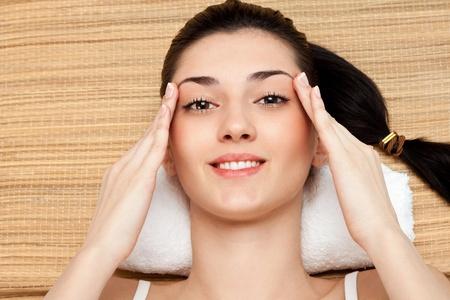 woman massage her head in massage studio, close up Stock Photo - 9129430
