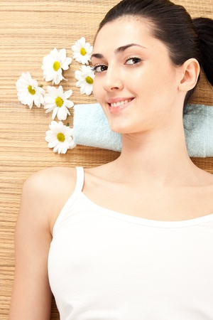 beautiful young woman in spa, health and beauty photo