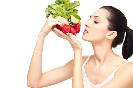 attractive woman eating a healthy dieting food, isolated on white photo