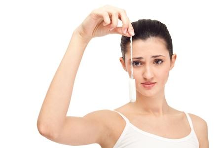 tampon: no volver a la menstruaci�n, mujer con tampones, aislados en blanco Foto de archivo