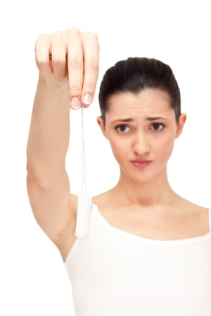 gynecologic: close up,  unhappy, woman  holding vaginal tampon, isolated on white