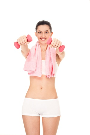 fitness girl exercising with dumbbells, on white background photo