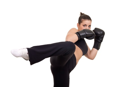 female kick: boxer woman giving kick- isolated on white