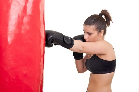 punching bag: young woman boxing- isolated on white Stock Photo