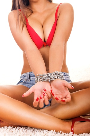 portrait of a sexy woman with chain bound hands Stock Photo - 9129405