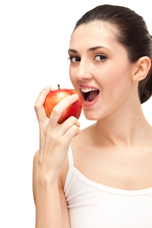 woman with white teeth eating a red apple,  isolated over white background photo