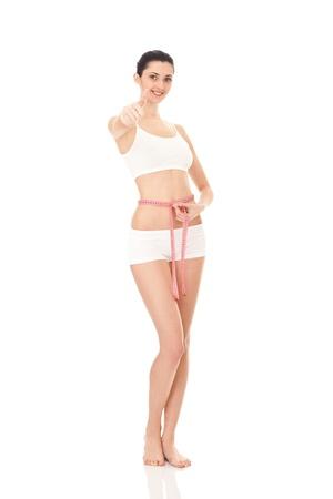 cintura perfecta: mujer medir de forma perfecta de bello cuerpo, concepto de estilos de vida saludables, aislado en blanco Foto de archivo