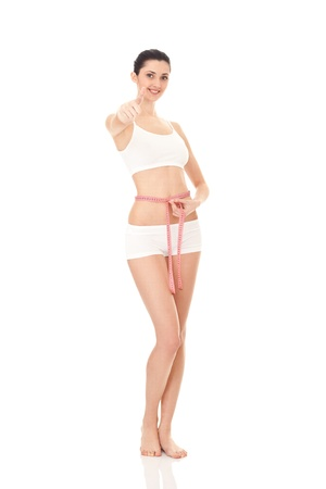 woman measuring perfect shape of beautiful body,  healthy lifestyles concept, isolated on white photo