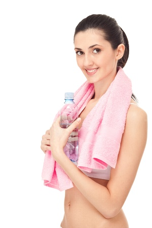 smiling young woman with water,  fitness, isolated over white background photo