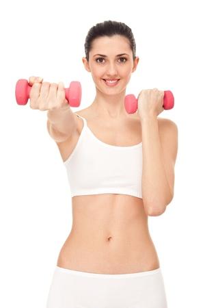 girl exercising with dumbbells, isolated on white background photo