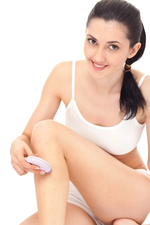 close up, beautiful woman shaving her legs, isolated on white Stock Photo - 9184766