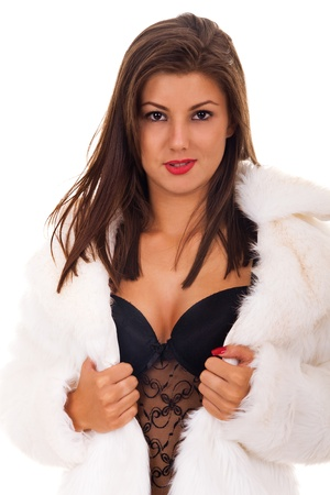 portrait of a beautiful and sexy woman wearing fur coat on white background Stock Photo - 9175387