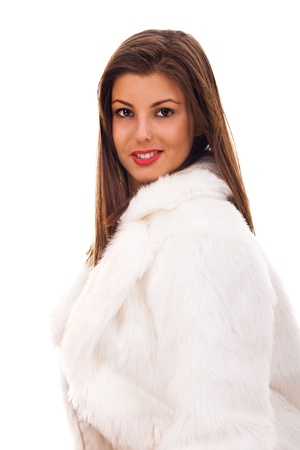 Portrait of very beautiful woman wearing fashionable winter fur coat posing before camera  photo