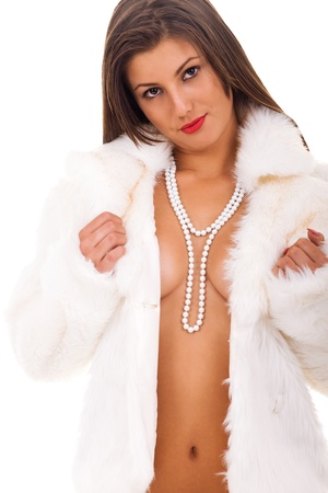 young naked woman wearing  pearl necklace with covering breast - isolated on white Stock Photo - 9175297