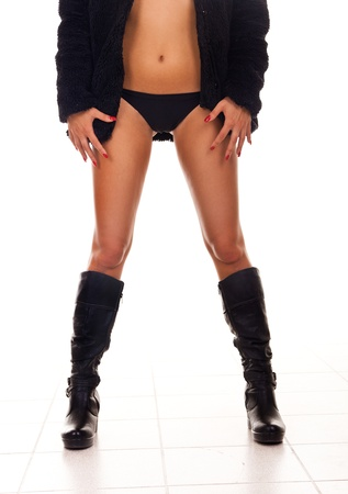 lower view of a woman's  legs in  black panties and boots Stock Photo - 9175406