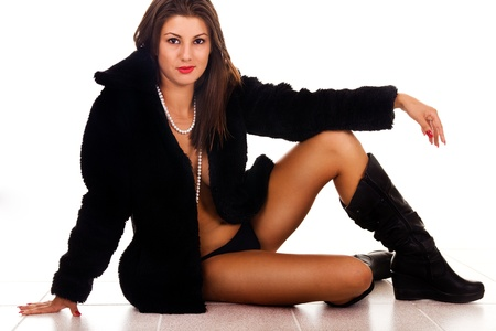 sexy woman sitting in coat with panties and boots Stock Photo - 9175357