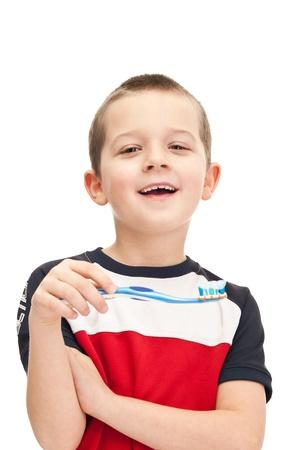 toothbrushing: adorable child brushing teeth, close up, isolated on white