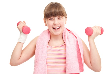 sporty girl teenager with dumbbells, isolated over white background photo