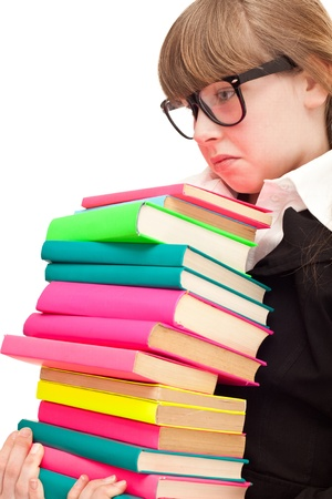 unhappy young girl with stack color books, isolated on white background  photo