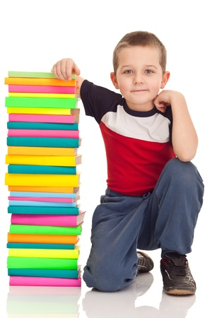 preschooler wunderkind with big stack books, isolated on white photo