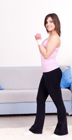 young woman in sportswear,  doing fitness exercises at home photo