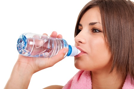 close up, young girl with bottle of water,  isolated on white photo