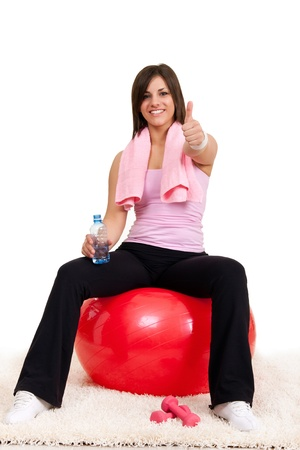 successes: satisfied woman after training with thumb up Archivio Fotografico