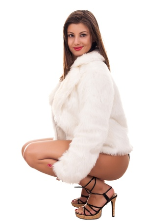 attractive sexy, naked girl wearing only fur coat Stock Photo - 9228124