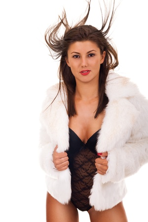 Portrait of very sexy woman wearing fashionable winter fur coat - isolated on white Stock Photo - 9228232