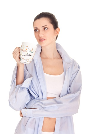 warm shirt: woman drinks morning coffee or tea,  isolated on white background Stock Photo