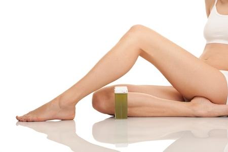 epilation:  depilating females legs, close up, isolated on white