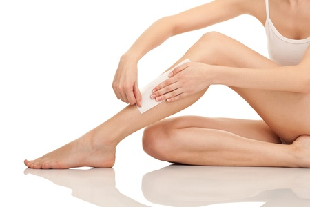 depilation female legs with waxing, isolated on white background Stock Photo - 9319923